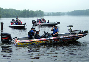 Team WYCD heads out onto Kent Lake in the WaveSpin Reel-wrapped boat prior to winning the 2013 KVD Charity Classic on June 10th with 5 bass weighing 13 pounds 15 ounces while led by WaveSpin Reels pro Don Watts