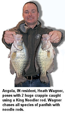 Angola, IN resident, Heath Wagner, poses with 2 huge crappie caught using a King Noodler rod. Wagner chases all species of panfish with noodle rods.