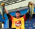 FLW Tour Pro winner Brandon McMillan holds up his two biggest bass from day four on Lake Okeechobee