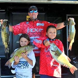 Brian Metry continues to lead the Bassmaster Northern Open after the day two weigh in on Lake St Clair shown here with his children and his big smallmouth bass
