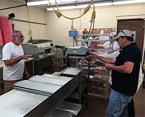 Bruce Kraemer looks on (L) as they check the certified scales on September 12, 2016 before weighing his big smallmouth bass.