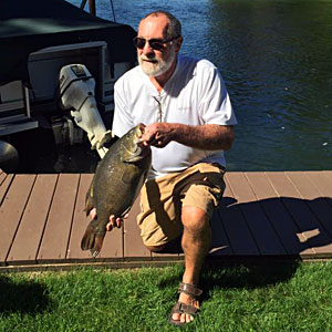 Bruce Kraemer shows his monster toad 9.98 pounds smallmouth bass he caught on a nightcrawler from Michigan's Indian River on September 11, 2016.