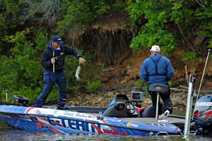 David Walker flips a West Point Lake largemouth bass into the boat on day one of the Pride of Georgia Elite Series event