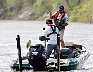 South Carolina bass pro Davy Hite flips a big smallmouth bass into the boat during his 2011 Elite series victory on Pickwick Lake