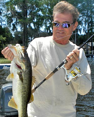 Doug Hannon dies at home March 28 - The Bass Professor is pictured here with a largemouth bass caught using one of his many innovative inventions, the WaveSpin Reel
