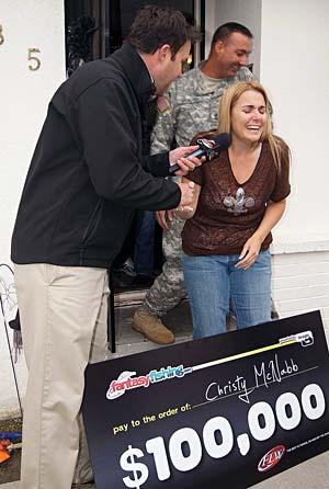 FLW Outdoors TV host Jason Harper surprises Fantasy Fishing point champion Christy McNabb of Kerman California with $100,000