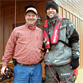 Alabama gentleman James Whitaker poses with Elite Series bass angler Aaron Martens after coming to the rescue with five gallons of gasoline on Lake Guntersville during the final practice day for the 2014 Bassmaster Classic