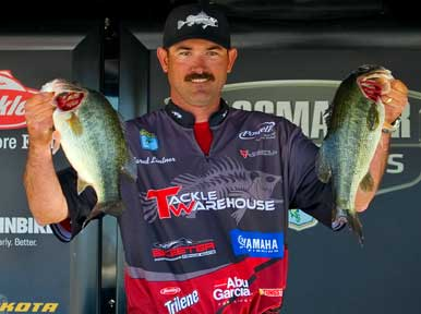 Jared Lintner of Arroyo Grande California with two of the bass that have put him on the verge of qualifying for the 2011 Bassmaster Classic, Photo by BASS Communication, Seigo Saito