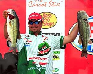 Diet Mountain Dew pro Jason Christie of Oklahoma slammed 25.33 pounds Friday to take the lead into the final day of the Bass Pro Shops PAA All Star Series on Lake Ray Hubbard