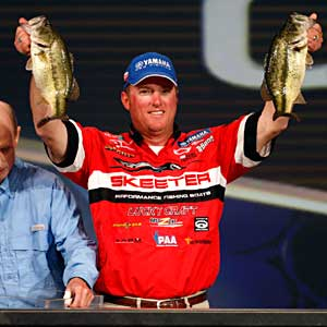 Kelly Jordan, pictured with two bass during the 2011 Bassmaster Classic, needs some help from others to make it to the 2012 Classic
