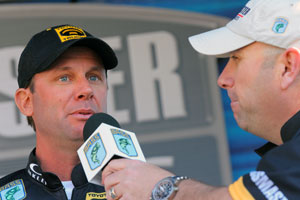 Kevin Vandam is in 2nd place 8 pounds behind leader Shaw Grigsby at the Elite Series Sunshine Showdown on the Harris Chain, here talking to emcee Dave Mercer