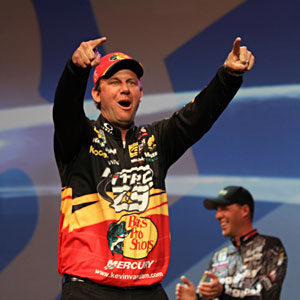 Kevin VanDam celebrates his record-tying 4th Bassmaster Classic victory pointing to his family