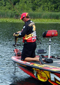 Kalamazoo Michigan Elite Series Angler Kevin VanDam lands another bass in his never ending quest to remain the best bass tournament angler in the world