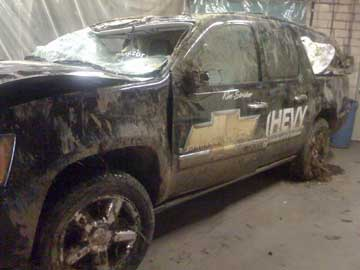 Driver side view of Kim Stricker's Team Chevy Suburban after his rollover accident in December 2008