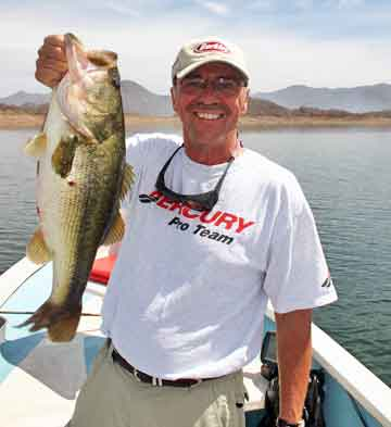 In the spring of 2008 Louie Stout visited Lake Mateos in Mexico and landed this  6-12 largemouth. Lake Mateos is a relatively new destination for bass fishing in Mexico. He was a guest of Berkley along with a group of other writes for Bassmaster magazine. This fish was the 2nd largest the group caught that week. He caught it on a 10-inch Power Worm.