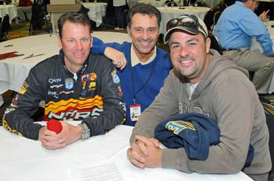 Louie Stout takes a moment to pose with Mark Zona and Kevin VanDam at the 2008 Bassmaster Classic media day. Aside from being business associates, these three have become very close friends.
