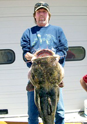 Rodney Akey with his record-setting catch 49.8 pounds flathead catfish from the St Joseph River in Michigan