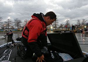 Bassmaster Classic rookie Ryan Said makes some final equipment checks while waiting to go on the Louisiana Delta