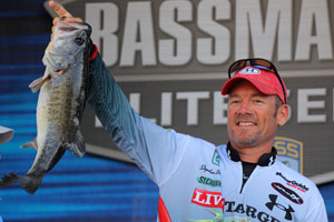 3rd place angler Stephen Browning weighs in a big largemouth bass from the Harris Chain