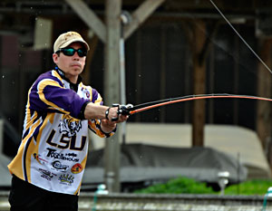 A member of the 2011 College Classic champion LSU Fishing Tigers fights a bass on Lake Verret
