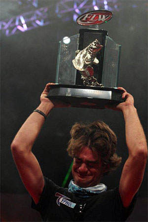 Theo Corcoran gets emotional hoisting his 2013 Forrest Wood Cup championship trophy after his co-angler victory August 15-18 on Louisiana's Red River