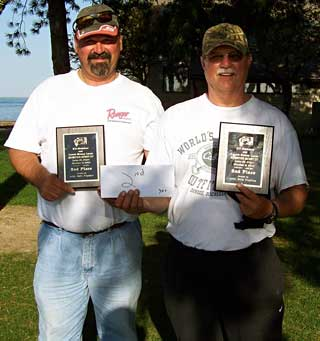 Second place finishers Hardy Tulgestka and Ted Prisbe display their trophies and winnings from the 2010 fall Monsterquest
